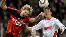 Keine Tore in Leverkusen: Hier bemühen sich Leverkusener Stefan Kießling, links, und der Kölner Pedro Geromel.