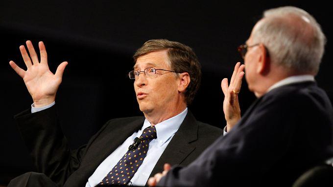 Microsoft-Gründer Bill Gates (l.) und Investmentguru Warren Buffett.