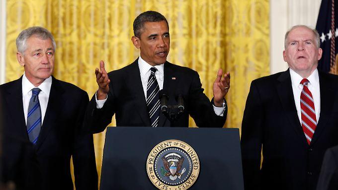 US-Präsident Obama stellt Hagel (l.) und Brennan vor.